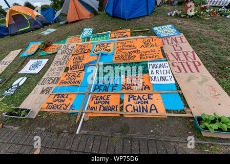 Protest encampment at Defence & Security Equipment International DSEI arms fair trade show, ExCel, London, UK. Protesters tents. Camp. Peace China - Stock Photo