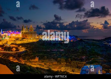 Sunset over Mellieha in Malta - Stock Photo