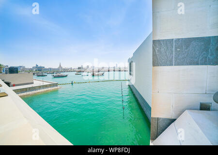View across Doha harbor to urban skyline from Museum of Islamic Arts interior design and architecture. - Stock Photo