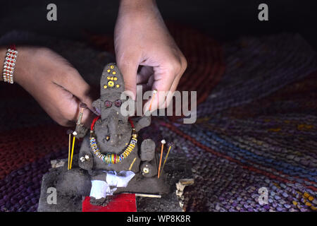 lord of ganesha, decorates indian boy, made of clay - Stock Photo
