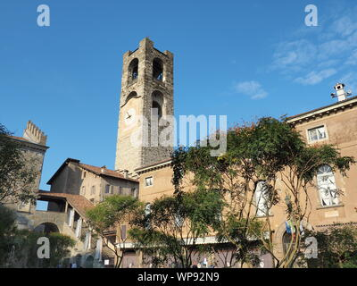 Bergamo, Italy. The old town. Landscape at the clock tower called Il Campanone. It is located in the main square of the upper town - Stock Photo
