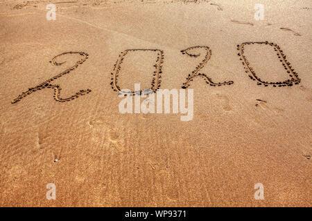 new year inscription on the sandy beach - Stock Photo