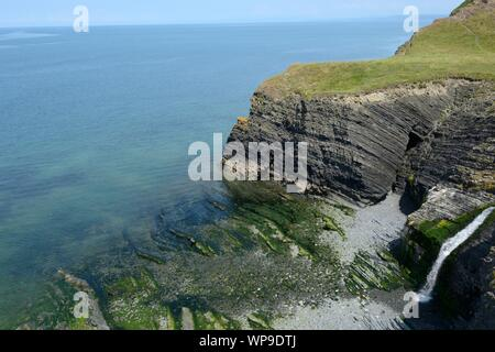 Cwm Buwch  on the Ceredigion Coast path where afon Drywi waterfall plunges to an inaccessible beach between New Quay and Aberaeron Wales UK - Stock Photo
