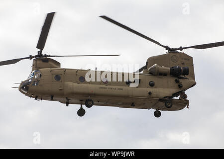 London, UK. 7 September, 2019. A military helicopter lands outside ExCel London during the sixth day of Stop The Arms Fair protests against DSEI, the - Stock Photo
