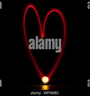 Heart shape light painting - Stock Photo