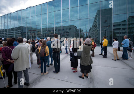 08 September 2019, Saxony-Anhalt, Dessau-Roßlau: Citizens stand in front of the entrance to the new Bauhaus Museum Dessau. After the opening ceremony, the exhibition can now be visited. The exhibition is entitled 'Versuchsstätte Bauhaus. The Collection'. Around 1000 exhibits will be on show, representing the special and worldwide influence of the legendary school of architecture, art and design. The new building for 28.5 million euros was built according to a design by Spanish architects. The Dessau Bauhaus collection is the second largest in the world. Photo: Hendrik Schmidt/dpa-Zentralbild/d - Stock Photo