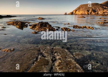Sunrise on the coast of Escullos. Natural Park of Cabo de Gata. Almeria. Spain. - Stock Photo