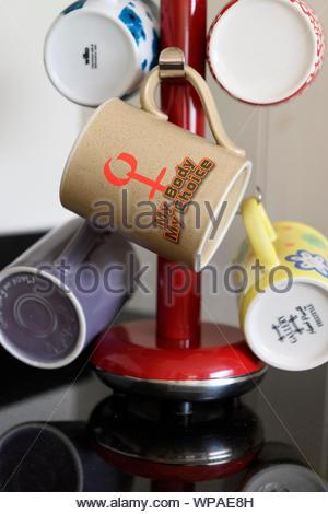Pro-choice slogan on Personal cup, Blandford, Dorset, England, UK - Stock Photo