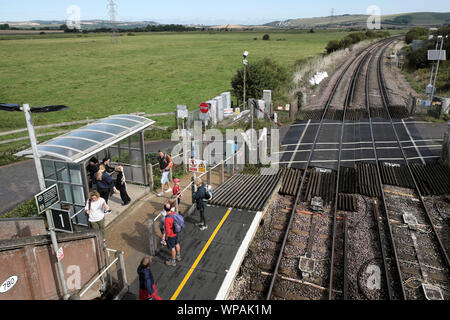 People tourists travellers waiting on Southease Station platform for a train heading to Brighton East Sussex in summer England UK  KATHY DEWITT - Stock Photo