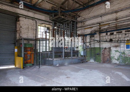 Old dirty room with the controller zone of pressure sensors, pump station and metal pipe system on ceiling and wall in factory or industrial building. - Stock Photo