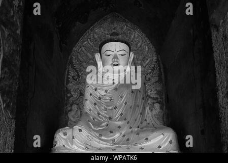 BAGAN, MYANMAR - 06 DECEMBER, 2018: Black and white picture of beautiful Buddha statue located inside the Ananda Temple in Bagan, Myanmar - Stock Photo