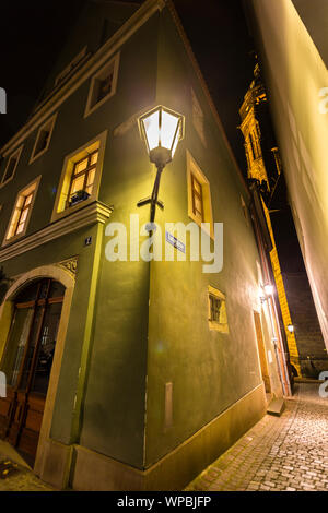 illuminated city houses and small streets of Pirna at Night, Saxony - Stock Photo