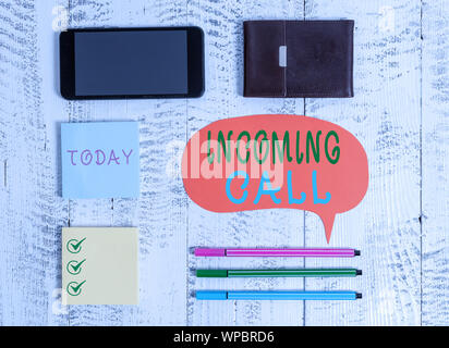 Word writing text Incoming Call. Business photo showcasing Inbound Received Caller ID Telephone Voicemail Vidcall Smartphone pens blank speech bubble - Stock Photo