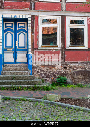 Stade, Germany - August 25, 2019: View at historical house in need of renovation in historical center in city of Stade, Germany at day. - Stock Photo