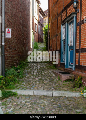Stade, Germany - August 25, 2019: View at cobbled alley in famous historical part of city of Stade, Germany at day. - Stock Photo