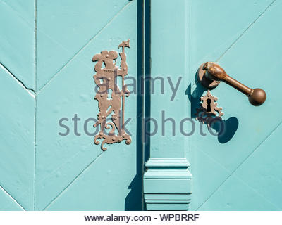 Stade, Germany - August 25, 2019: Detail shot of door lock of old historical town hall in Stade, Germany at sunny day. - Stock Photo