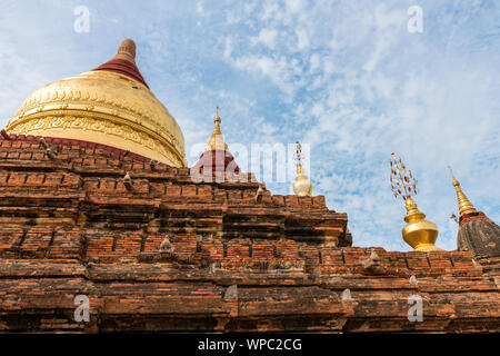 Wide angle picture of the top of buddhist building called Dhammayazika Pagoda located inside the archeological park of Bagan in Myanmar - Stock Photo