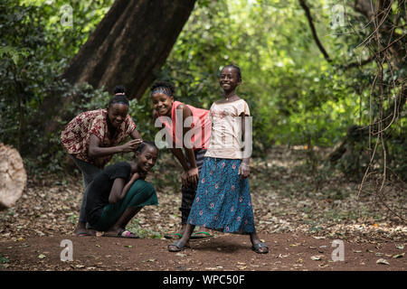 ARBA MINCH, ETHIOPIA-OCTOBER 27, 2018: Unidentified girls play and do their hair in Nechisar National Park in this illustrative editorial. - Stock Photo