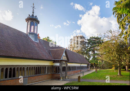 Gabled porch and cloister walk of historic 17th century Long Alley Almshouses, Abingdon-on-Thames, Oxfordshire, south-east England, UK - Stock Photo