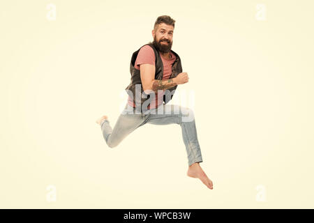 Hurry up. Guy happy cheerful face having fun run jumping. Life in motion. Man bearded guy run away. Always in motion. Last chance. Following his dream. Barefoot guy hurries to beach. Run away. - Stock Photo