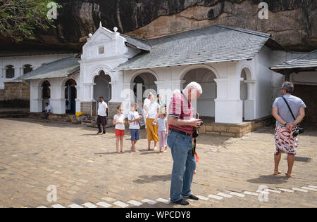 DAMBULLA / SRI LANKA - AUGUST 07, 2019:  The Unspecific man is looking at the camera in front of cave in Dambulla, Sri Lanka. The largest cave for the - Stock Photo
