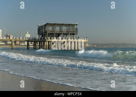 Durban, South Africa, people on landmark Ushaka jetty in early morning, beach, landscape, background, city, African landscapes - Stock Photo