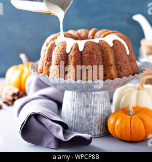 Pumpkin bundt cake with cream cheese filling - Stock Photo