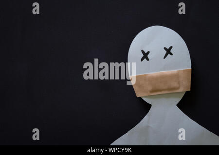Paper person with shuted mouth. Violence concept - Stock Photo