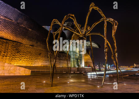 Night view of Maman spider by the artist Louise Bourgeois located outside the Guggenheim Museum, Bilbao, Basque Country, Spain