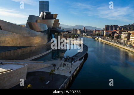 Aerial cityscape of Guggenheim Museum Bilbao on Nervion river, Bilbao, Basque Country, Spain - Stock Photo