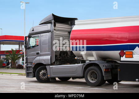 Gasoline truck on the background of a gas station - Stock Photo