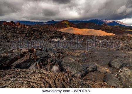 Rough surface of frozen lava after Mauna Loa volcano eruption, Hawaii, USA - Stock Photo