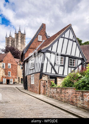 2 July 2019: Lincoln, Lincolnshire, UK - Crooked half-timbered house in Michaelgate, Lincoln. - Stock Photo