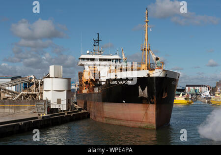 Poole Harbour, Dorset, England, UK. September 2019. Sand Heron a trailing suction hopper dredger leaving her berth in Poole Harbour. - Stock Photo
