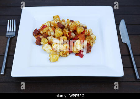 Home cooked hash of halloumi, chorizo, potatoes, fried onion and red pepper. The dish is a popular brunch dish. - Stock Photo