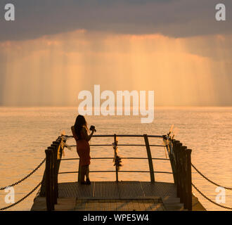 watching the sunset on the thames - Stock Photo