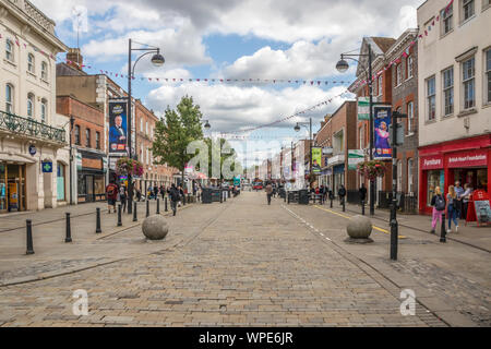 High Wycombe, England - August 15th 2019: View down the High Street. The town lies to the north west of London in Buckinghamshire. - Stock Photo