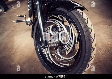 close up. the front wheel is a cool custom motorcycle - Stock Photo