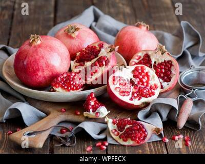 Close-up Of Pomegranates In Plate On Table - Stock Photo