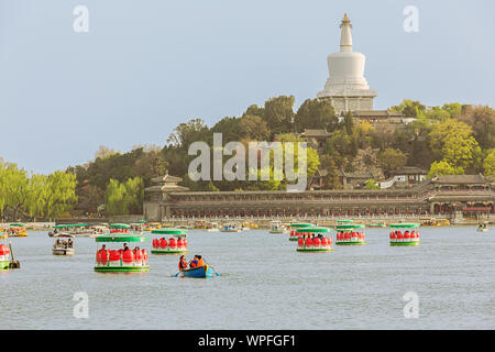 Editorial: BEIJING, CHINA, April 6, 2019 - Jade Flower Island with the White Pagoda in Beihai Park in Beijing - Stock Photo