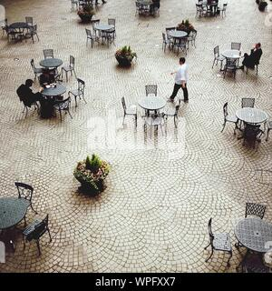 High Angle View Of People Sitting At Outdoor Cafe At Night - Stock Photo