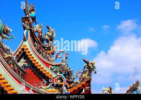 Creative Roof Of Chinese Temple Against Blue Sky - Stock Photo