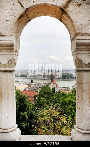 Mid Distance View Of Hungarian Parliament Building Seen Through Arch - Stock Photo