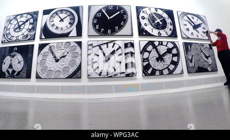 Berlin, Germany. 09th Sep, 2019. A woman photographs the work 'World Time Clock' at the Berlinische Galerie. It is part of the exhibition 'Bettina Pousttchi. In Recent Years', which will open on 12 September. Credit: Paul Zinken/dpa/Alamy Live News - Stock Photo