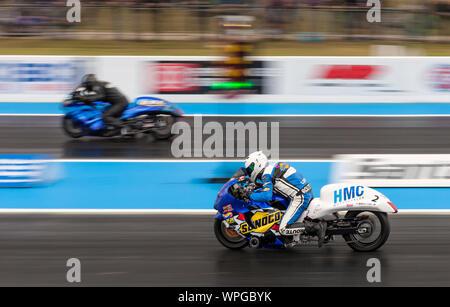 Super Street Bike Drag Racing at Santa Pod Raceway. Mogens Lund Suzuki Hayabusa nearside, V Steve Venables far side. - Stock Photo