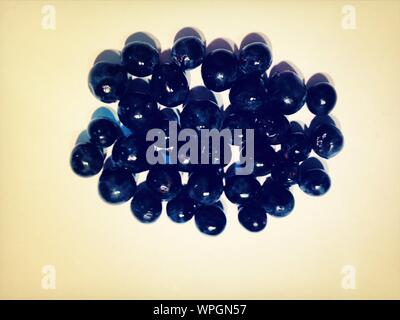 Close-up Overhead View Of Marbles On White Surface - Stock Photo