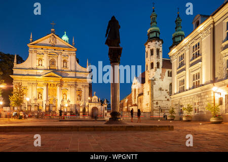 Night falls on Maria Magdalena square in Krakow old town, Poland. - Stock Photo