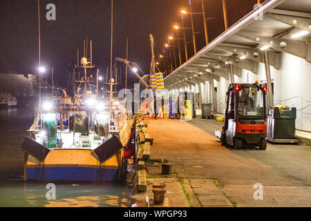 Lorient (Brittany, north-western France): night view of the fishing port of Keroman - Stock Photo