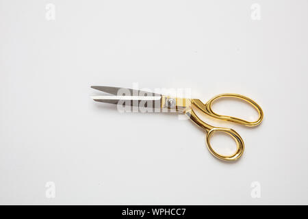 Scissors gold and silver color isolated against white background, copy space, top view. Tailor, barber concept - Stock Photo