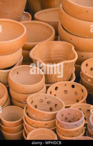 Full Frame Shot Of Earthenware For Sale At Workshop - Stock Photo